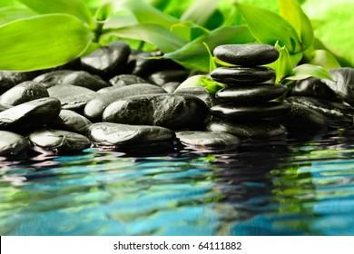 zen stones in the water