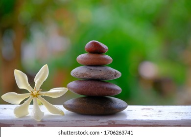 zen stones and white flower