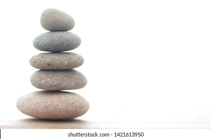Zen yoga spa stones balanced on one another