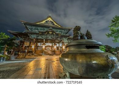 Zenko-ji Temple complex late night view. Jokoro (Incense Burner) and Saisenbako (offerings box) at Hondo (Main Hall) in Nagano City, Japan