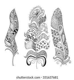 Zentangle stylized elegant feathers set. Hand drawn vintage illustration for adult anti-stress coloring page on white background. Ethnic decorative elements.