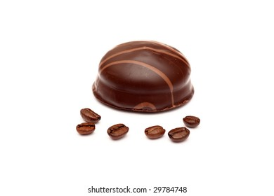 Zephyr coated chocolate and and coffee beans on white background. Close-up.