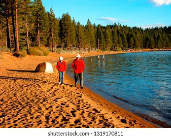 Zephyr Cove, Lake Tahoe, Nevada, Senior couple strolling on the beach in late evening light May 26, 2004
