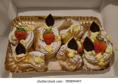 Zeppole decorated with strawberries and chocolate leaves, good 2018