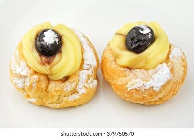 Zeppole - italian pastries on white plate