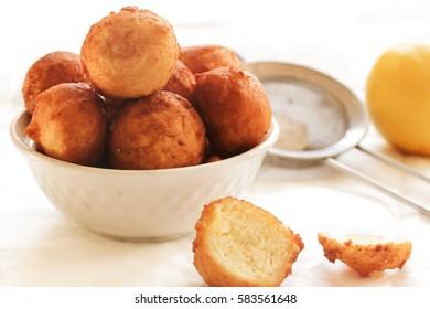 Zeppole - Italian Ricotta Donuts on white background, selective focus