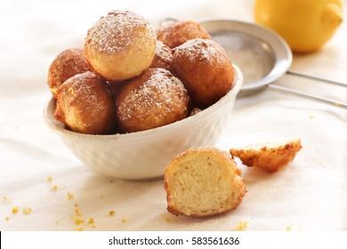 Zeppole - Italian Ricotta Doughnuts on white background, selective focus