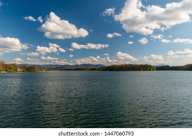 Zermanice water reservoir with hills of Moravskoslezske Beskydy mountains on the background near Havirov city in Czech republic during nice springtime day with blue sky and few clouds