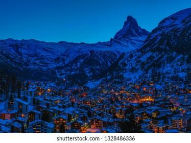 Zermatt by night. Zermatt in front of the Matterhorn. Mountain Switzerland by night. Swiss village.