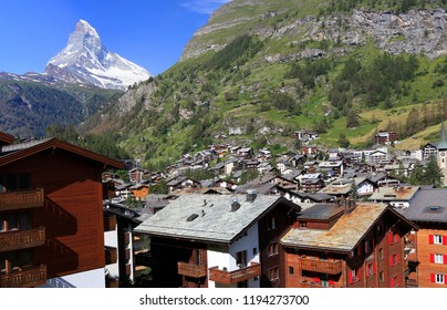 Zermatt famous ski and hiking resort with chalets and Matterhorn on the background, Switzerland