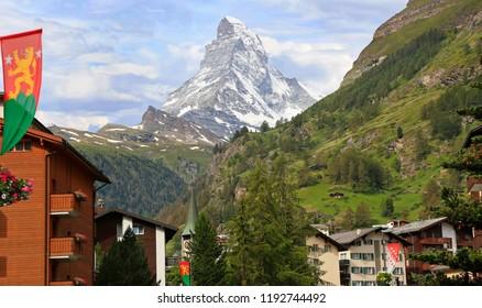 Zermatt hotels, church tower with the Matterhorn on the background, Switzerland