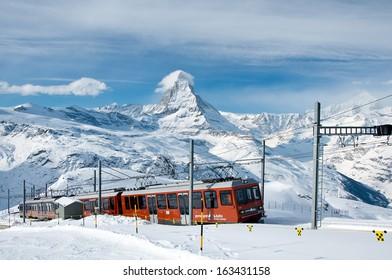 ZERMATT -?? JANUARY 17: Red train climbing up to Gornergrat station on January 17, 2013 in Zermatt, Switzerland. The Gornergrat rack railway is the highest open-air railway in Europe.