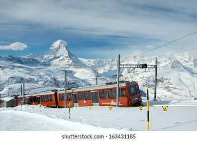 ZERMATT - JANUARY 17: Red train climbing up to Gornergrat station on January 17, 2013 in Zermatt, Switzerland. The Gornergrat rack railway is the highest open-air railway in Europe.