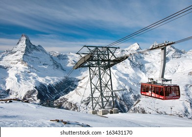 ZERMATT -?? JANUARY 18: Cable car climbing up from Blauherd to Rothorn with Matterhorn in the background on January 18, 2013 in Zermatt, Switzerland. The Rothorn paradise is one of the main ski areas.