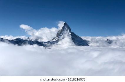 Zermatt Matterhorn and glacier view mountain winter snow landscape sea of fog clouds sunset