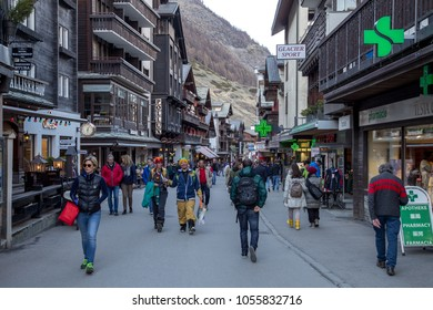 Zermatt, Switzerland - April 11, 2017: People walking on the main road in the city centre