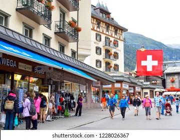 ZERMATT, SWITZERLAND - AUG 21,2018 : Tourists are walking in main shopping street in Zermatt, Switzerland