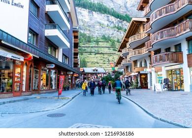 ZERMATT, SWITZERLAND - AUG 26, 2018: Tourists at street view of old town Zermatt at the center in Zermatt, Switzerland.