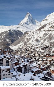 Zermatt, Switzerland - Circa April 2019 - The famous snow capped Swiss Alp peak of Matterhorn towering over the ski village