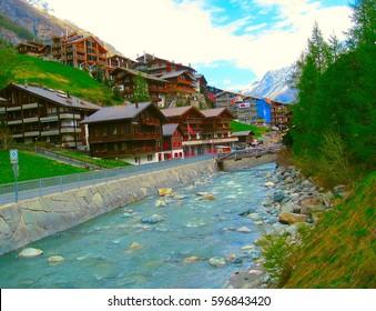 Zermatt, Switzerland, the famous ski resort town in the Swiss Alps at the base of the Matterhorn. Mountain river in Zermatt