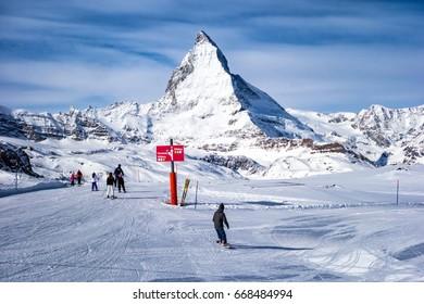 Zermatt, Switzerland- Feb 28, 2016: skiing with Matterhorn mountain as background in winter season.The Matterhorn is a mountain of the Alps