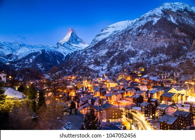 Zermatt, Switzerland - January 5, 2017: The world-famous Matterhorn glows in the early morning above the Swiss village of Zermatt, as the sun prepares to rise over the Alps.
