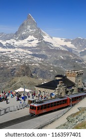 ZERMATT, SWITZERLAND - JULY 02, 2018: Tourists arriving in Gornergrat Railway final station, enjoying the Matterhorn view and preparing to hike the mountains.
