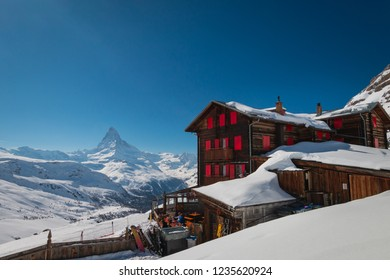 Zermatt, Switzerland - March 21, 2018: Hotel and mountain restaurant Fluhalp at elevation of 2606 meters in the skiing and hiking area of of Zermatt, Switzerland with Matterhorn