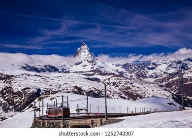 Zermatt, SWITZERLAND - May, 2018: The Swiss alpine train transporting tourist to the top of the mountain to see Matterhorn. Gornergrat train in May, 2018, Zermatt