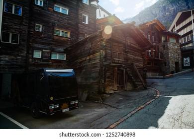 ZERMATT,, SWITZERLAND - May, 2018: Tourists visiting Zermatt.  Zermatt lies at the foot of the highest mountains in the entire Alpine mountain range.