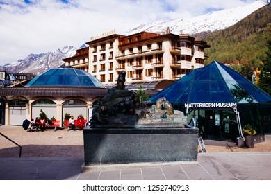 ZERMATT, SWITZERLAND - May, 2018: Tourists visiting Zermatt.  Zermatt lies at the foot of the highest mountains in the entire Alpine mountain range.