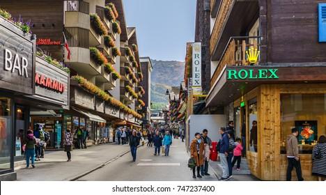 ZERMATT, SWITZERLAND - OCTOBER 07, 2017 : Main street view of mountain summer and winter village of Zermatt, Switzerland.