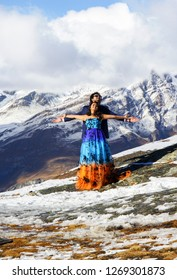 Zermatt, Switzerland - October 15, 2016: Bollywood actors from India in summer costumes are making film on the winter snow mountain over the Swiss Alps. Swiss Alps are attractive background