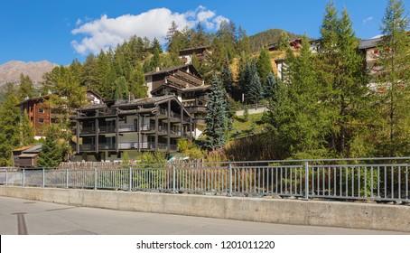 Zermatt, Switzerland - September 15, 2018: buildings of the town of Zermatt along the Matter Vispa river. Zermatt is a municipality in the district of Visp in the Swiss canton of Wallis.