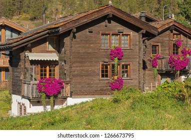 Zermatt, Switzerland - September 15, 2018: wooden houses in the town of Zermatt. Zermatt is a municipality in the Swiss canton of Wallis, it is a famous mountaineering and ski resort.