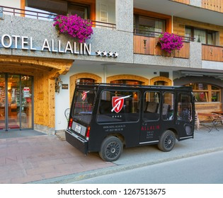 Zermatt, Switzerland - September 15, 2018: an electric vehicle of the Hotel Allalin at the entrance to the hotel in the town of Zermatt. Zermatt is a car-free zone, electric vehicles are used there.