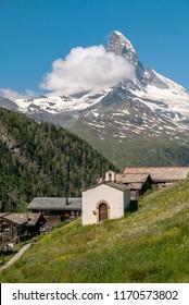 Zermatt village with little chapel and Matterhorn (Monte Cervino, Mont Cervin) in background. Beautiful outdoor scene in Swiss Alps, Valais canton, Switzerland, Europe.