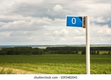 zero kilometer column. blue road sign marking the distance traveled from the beginning of the road. mileage post
