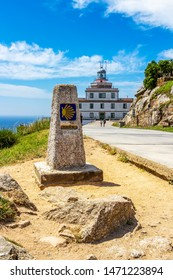 Zero kilometer marker at Cape Finisterre, Cabo Fisterra or Cabo Finisterre - the end of the Way of St. James, Camino de Santiago, Galicia, Spain, the lighthouse in the background