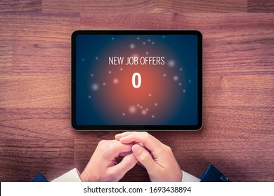 Zero new job offers concept. Unemployed business person looking for a job on digital tablet in time of economic crisis (recession) and check new job offers during breakfast.