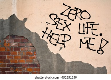 Zero Sex Life. Help Me! - Handwritten graffiti sprayed on the wall, anarchist aesthetics. Dissatisfaction because of sexual abstinence - virginity or long-time absence of intimate partnership