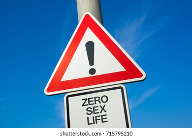 Zero sex life - traffic sign with exclamation mark to alert, warn caution - problem and trouble because of absence and lack of sexual intercourse leading to sexless abstinence and celibacy