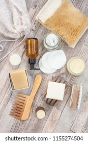 Zero waste bathroom accessories, natural sisal brush, wooden comb, deodorant, shea butter, solid soap and shampoo bars, reusable cotton make up removal pads, make up remover in a glass container.