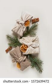 Zero waste, Christmas eco-friendly gift wrapping in traditional Japanese Furoshiki style, environmental gift wrapping concept, eco friendly banner
