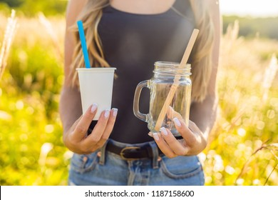 Zero waste concept. Use a plastic glass and plastic straw or mason jar and bamboo straw. Zero waste, green and conscious lifestyle concept. Reusable on the go drink container ideas