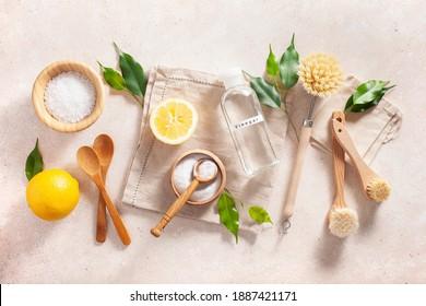 zero waste eco friendly cleaning concept. wooden brushes, lemon, baking soda, vinegar