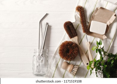 zero waste food cleaning. eco natural coconut soap and brushes for washing dishes, metal straws, eco friendly flat lay. sustainable lifestyle concept. plastic free items. reuse, reduce