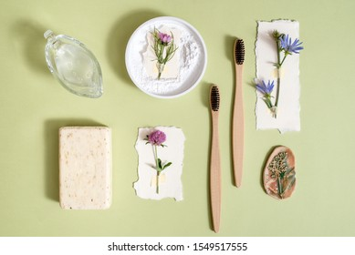 Zero Waste Lifestyle. Hygiene. toothbrush, powder for cleaning teeth, natural soap, vegetable lotion, fresh flowers. Nature concept. Flat lay.