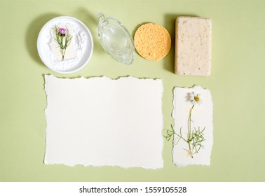 Zero Waste Lifestyle. Hygiene. toothbrush, powder for cleaning teeth, natural soap, vegetable lotion, fresh flowers. Nature concept. Flat lay. Notebook for inscription.Torn paper, postcard.Copy space