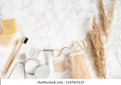 zero waste set for bathing on light marble background. flat lay with copy space